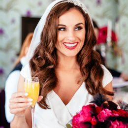 Happy bride with drink Belle Epoque